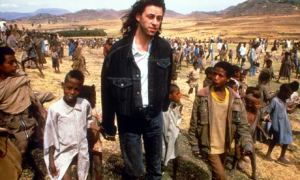 Bob Geldof, surrounded by displaced Ethiopians in the famine.